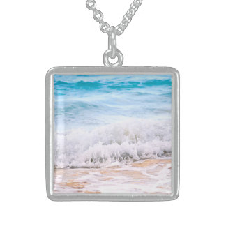 Waves breaking on tropical shore necklaces