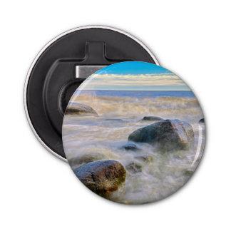 Waves crashing on shoreline rocks bottle opener