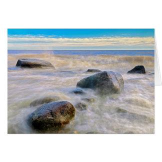 Waves crashing on shoreline rocks card