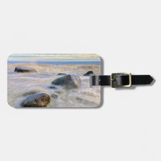 Waves crashing on shoreline rocks luggage tag