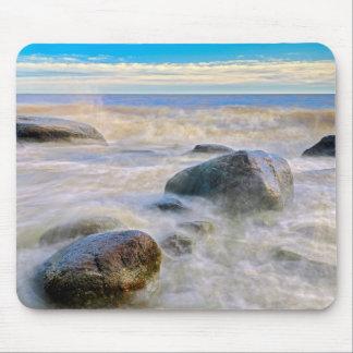 Waves crashing on shoreline rocks mouse mat