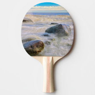 Waves crashing on shoreline rocks ping pong paddle
