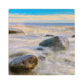Waves crashing on shoreline rocks wood coaster
