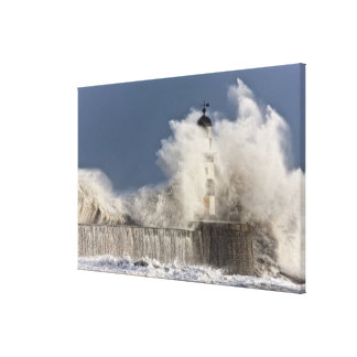 Waves Crashing Up Against A Lighthouse Canvas Print