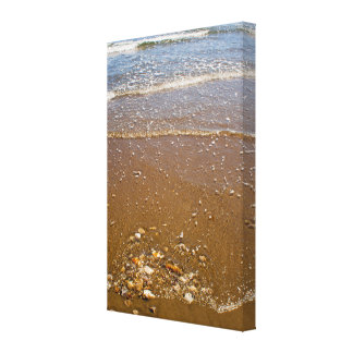 Waves Splashing Against Pebbles on a Beach Canvas Canvas Print