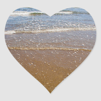 Waves Splashing Against Pebbles on a Beach Heart Sticker