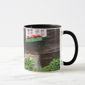 Wayside shrine in a mountain village mug