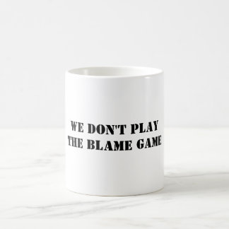 WE DON'T PLAYTHE BLAME GAME BASIC WHITE MUG