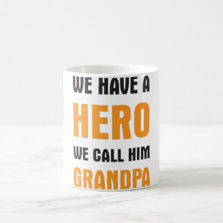 WE HAVE A HERO WE CALL HIM GRANDPA COFFEE MUG