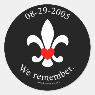 We remember round sticker