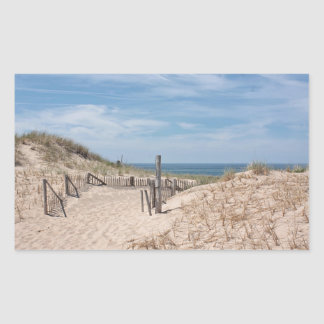 Weathered beach fence and sand dunes rectangular sticker