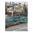 Weathered fishing nets on a harbour pier postcard