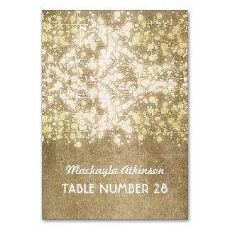 wedding escort cards string lights gold glitter table card