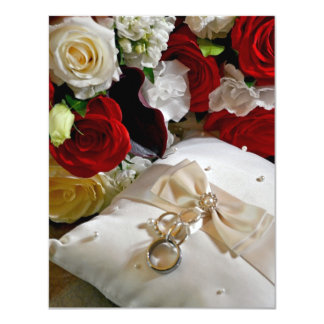 Wedding invitation with roses and rings on front