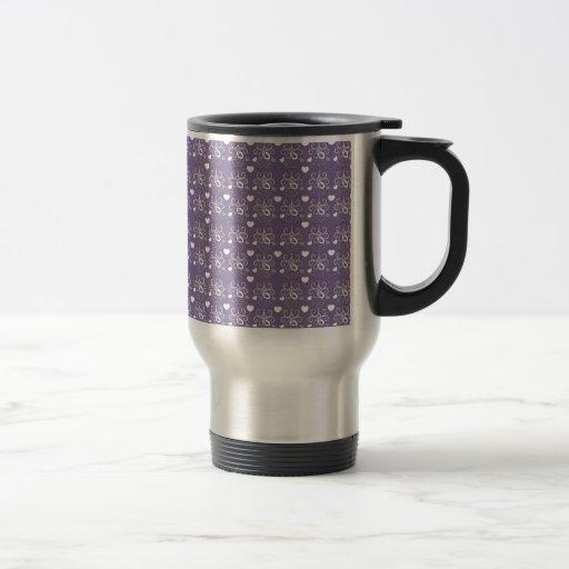 Wedding rings silver on dark purple coffee mugs