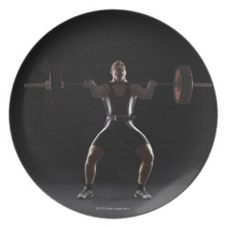 Weightlifter jerking weight party plate