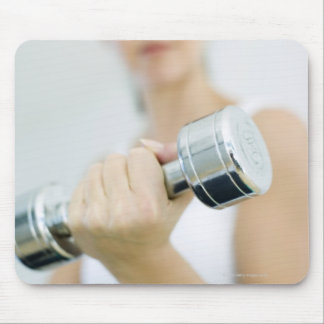 Weightlifting. Woman lifting dumbbells. This Mouse Pad