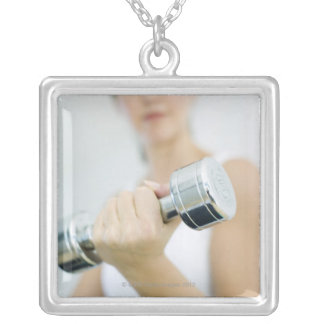 Weightlifting. Woman lifting dumbbells. This Silver Plated Necklace