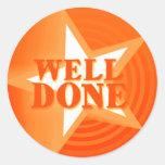 Well done star praise sticker orange