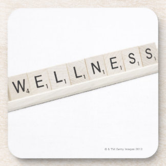 Wellness Spelled On A Word Board Game. Drink Coasters