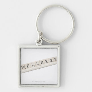 Wellness Spelled On A Word Board Game. Key Ring