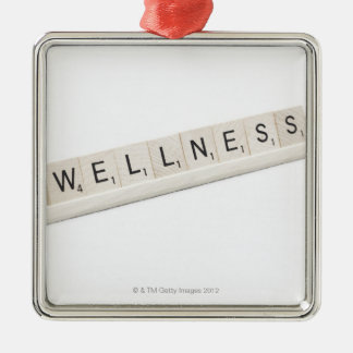 Wellness Spelled On A Word Board Game. Silver-Colored Square Decoration