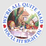 WE'RE ALL QUITE MAD,  YOU'LL FIT RIGHT IN ROUND STICKER