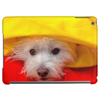 West Highland White Terrier peeking out of yellow