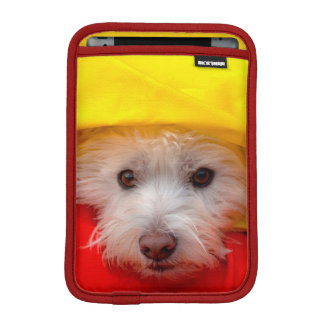 West Highland White Terrier peeking out of yellow iPad Mini Sleeve