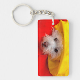 West Highland White Terrier peeking out of yellow Key Ring