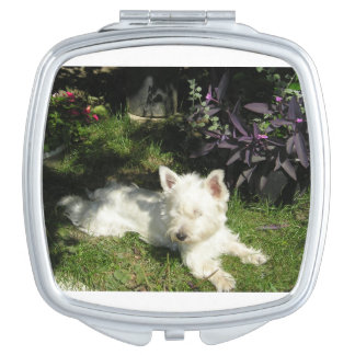 westie laying 3.png travel mirrors