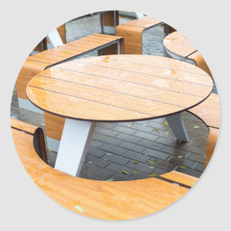 Wet round outdoor cafe tables on the street round sticker