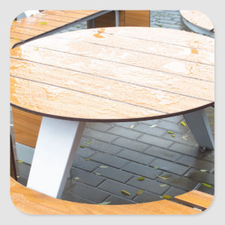 Wet round outdoor cafe tables on the street square sticker