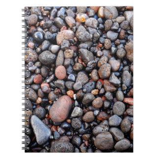 Wet volcanic pebbles spiral notebook