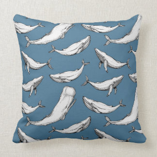 Whales are everywhere on blue cushion
