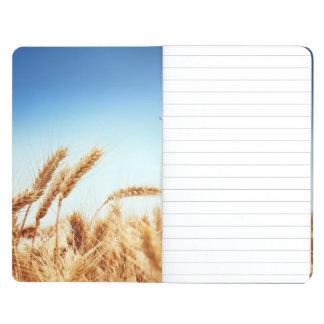 Wheat field against blue sky journal