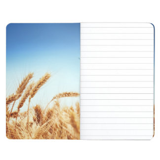 Wheat field against blue sky journals