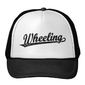 Wheeling script logo in black distressed trucker hat