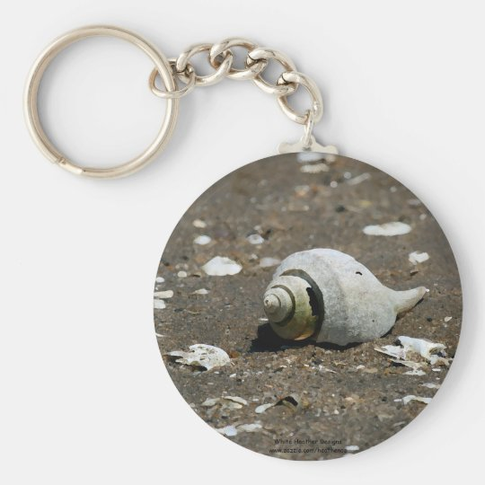Whelk shell on the beach - key chain