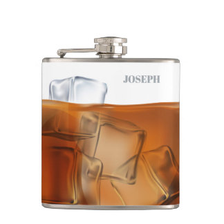 Whiskey with ice background flask