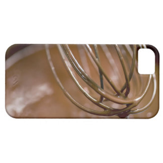 Whisking the chocolate in a saucepan to melt the iPhone 5 cases