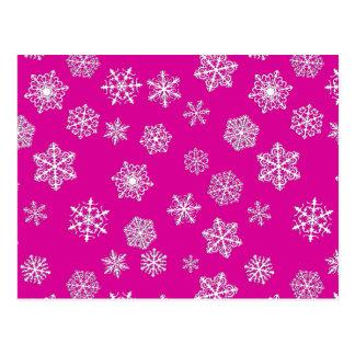 White 3-d snowflakes on a fuchsia pink background postcard