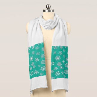 White 3-d snowflakes on a turquoise background scarf