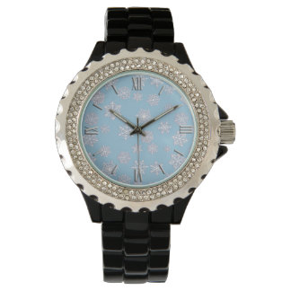 White 3-d snowflakes on an ice blue background watch