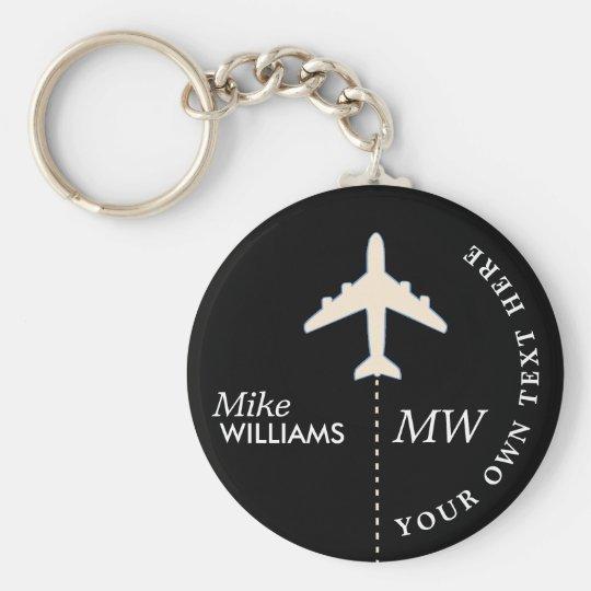 white aeroplane on black keychain with name