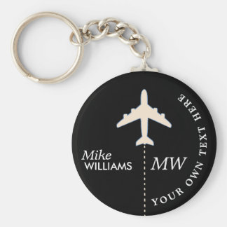 white airplane on black keychain with name