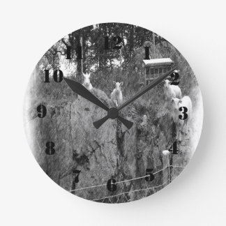 White and black sheep drawing round clock