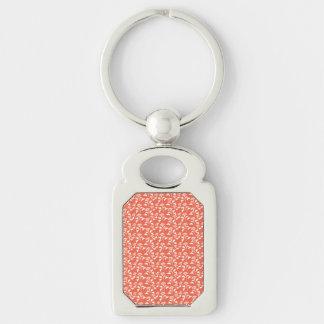 white and orange flower pattern keychains