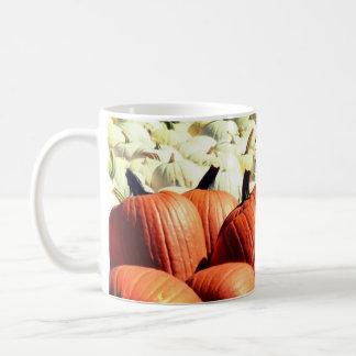 white and orange pumpkin mug