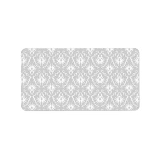White and Pastel Gray Damask Design. Label